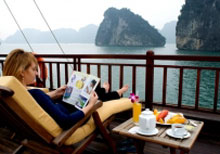relax on the sundesk on a luxury Halong bay cruise reviews as best of 5 day Hanoi tour package from malaysia